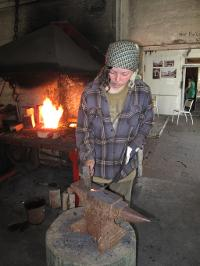 A young blacksmith student working with history